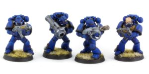 Tactical Marines (group with missile launcher and meltagun)