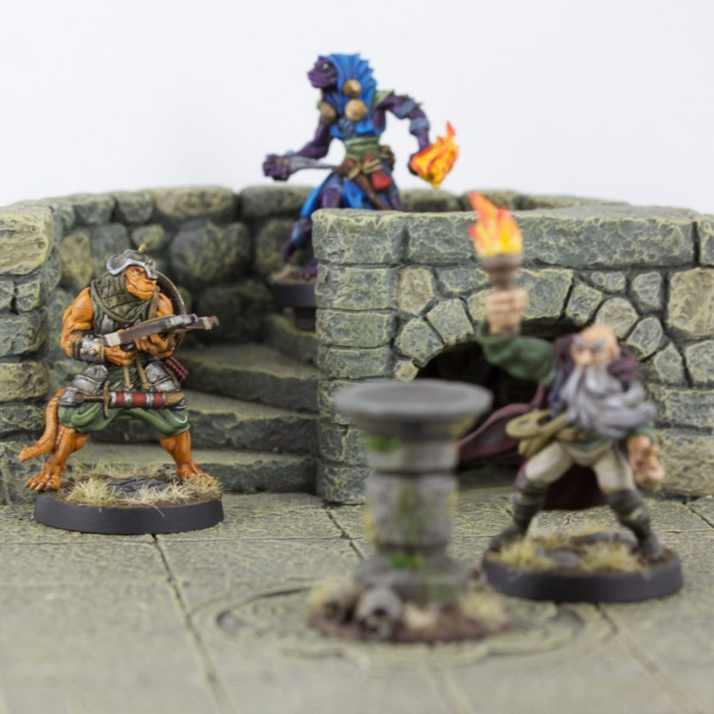 A Iguan Marauder comes down the stairs to find a wizard about to light the brazier.